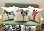 Part of our African homeware range, our animal decorative cushion is a beautiful addition to your home. The white cushion with graphics of zebras, giraffes and elephants, is the perfects sofa cushion and chair cushion.