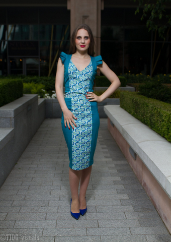 A turquoise midi dress, The Eki is our beautiful version of a bodycon dress, the turquoise pencil midi dress incorporating African print panelling into the design to create a unique take on a turquoise shift dress. With pleated shoulders, a modern square neckline and midi length, this African print dress is perfect for social and formal occasions.