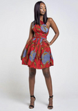 A red multi way wrap dress, The Lola, is a versatile African print dress that can be styled to match your mood or the occasion. The Ankara style dress can be worn as a chic halter neck midi dress, a sleeveless v neck dress, a wrap dress, a bandeau midi dress, a cross front dress and more. The red midi dress is perfect for work and social occasions and the wrap skater dress is made to measure.