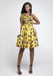 A yellow multi way wrap dress, The Lola, is a versatile African print dress that can be styled to match your mood or the occasion. The Ankara style dress can be worn as a chic halter neck midi dress, a sleeveless v neck dress, a wrap dress, a bandeau midi dress, a cross front dress and more. The yellow midi dress is perfect for work and social occasions and the wrap skater dress is made to measure.