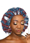 A beautiful blue African silk bonnet, The Buki Ankara bonnet is satin lined with elastic to ensure the sleep cap is comfortable to wear. Our blue satin cap is perfect for braids, locx, weaves, crochet and natural hair.