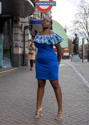 A stunning royal blue midi dress, The Dami takes a classic blue bodycon midi dress and upgrades it to incorporate African style. The African print overlay of the off shoulder dress is full of vivid shades of blue, making the bardot midi dress perfect for styling up or down. Pair the African print dress with trainers for a casual look or with heels for a more formal look.