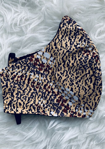 This African print brown face mask, available with or without a filter, mimics a leopard print design to create a stylish but comfortable leopard print face mask.
