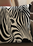 A beautiful black and white cushion, the African inspired decor is a bold Zebra print cushion perfect for making a statement in your home. The zebra graphic makes this African homeware the perfect addition to your home, the knitted cotton cushion the ideal sofa cushion or chair cushion.