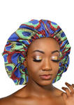 A beautiful green African silk bonnet, The Buki Ankara bonnet is satin lined with elastic to ensure the sleep cap is comfortable to wear. Our green satin cap is perfect for braids, locx, weaves, crochet and natural hair.