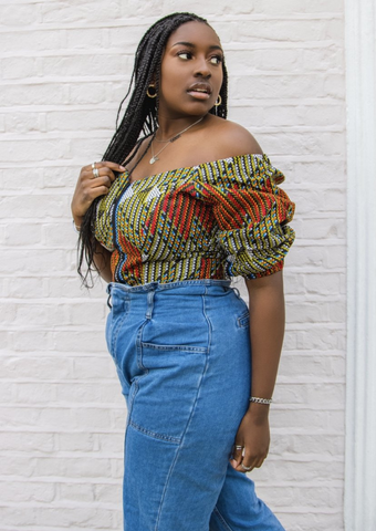 An orange and green off shoulder top, The Bola, with its striking African print brings a unique Ankara style orange and green bardot top to your wardrobe. The African print top with bardot neckline is the perfect long sleeve summer top, transcending seasons to provide you with an off shoulder blouse for all year round.