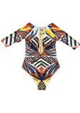 A stunning cut out swimsuit, this tribal African print one piece swimsuit is the perfect addition to our women's swimwear collection. The long sleeve swimsuit is effortlessly elegant and a summer must have.