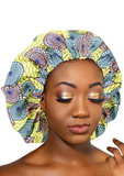 A beautiful yellow African silk bonnet, The Buki Ankara bonnet is satin lined with elastic to ensure the sleep cap is comfortable to wear. Our yellow satin cap is perfect for braids, locx, weaves, crochet and natural hair.