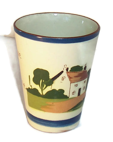 Torquay Motto Ware Watcombe Tumbler front view with trees and house