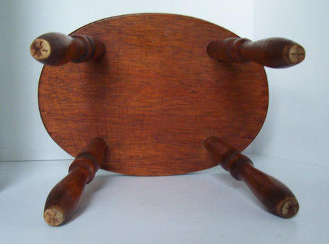 Charming Oval Wooden Stool with Turned Legs and Cottage Painting- bottom leg view