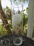 Etched Glass Unicorn Vase by Former Steuben Glass Artist Perry Coyle  on table with palms