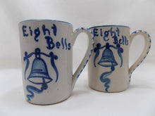 "Stoneware Dorchester Pottery Works Pair of Mugs by Knesseth Denisons ""Eight Bells"" side by side front view"