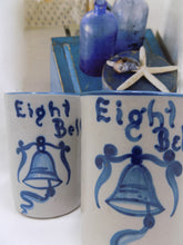 "Stoneware Dorchester Pottery Works Pair of Mugs by Knesseth Denisons ""Eight Bells""  with glass bottles and star fish"