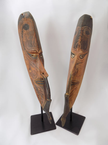 Papua New Guinea Carved Masks on Stands Sepik River Area Pigmented Decorations Cowry Shell Eyes main front view