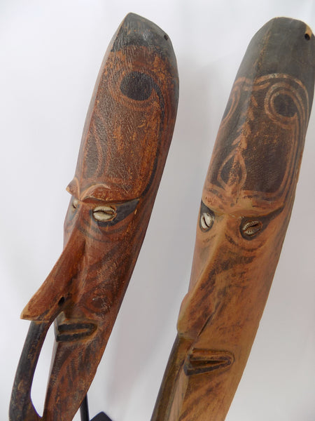 Papua New Guinea Carved Masks on Stands Sepik River Area Pigmented Decorations Cowry Shell Eyes face close up