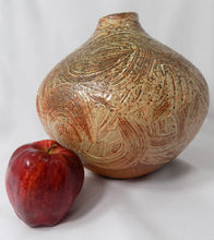 Stoneware, Large, Carved, and Textured Pot Signed Jens next to red apple