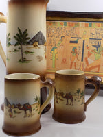 4904 Antique Haynes Ware Tankard Pitcher - Two Mugs - Egyptian Decoration close up with framed picture-1200 x 1600.jpg