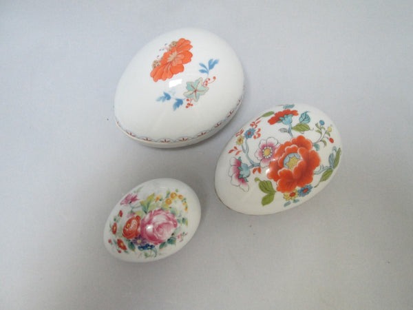 Limoges Porcelain Trio of Egg Shaped Trinket Boxes Maker Marked Full View