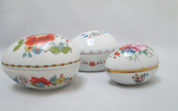 Limoges Porcelain Trio of Egg Shaped Trinket Boxes Maker Marked Side View