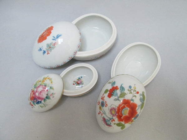 Limoges Porcelain Trio of Egg Shaped Trinket Boxes Maker Marked Tops Off
