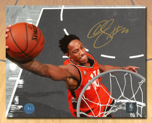 DeMar DeRozan Toronto Raptors Autographed Spotlight Netcam Dunk 8x10 Photo