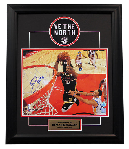 Demar Derozan Toronto Raptors Autographed Netcam Dunk Over Curry 19x23 Frame