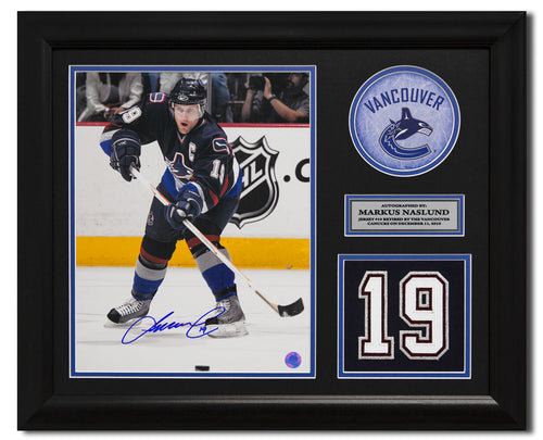 Markus Naslund Vancouver Canucks Signed Retired Jersey Number 23x19 Frame