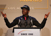 "National Student Council leader Terrell (Tj) Mitchell speaks at the GLSEN Respect Awards - Los Angeles, proudly wearing the RESPECT Snapback: A black snapback hat with the world RESPECT written across the front in large capitol white letters, and a golden ""E."""