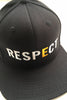 "RESPECT Snapback: A black snapback hat with the world RESPECT written across the front in large capitol white letters, and a golden ""E."""