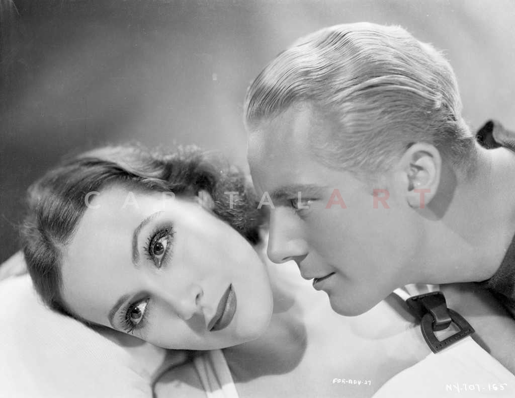 dfac5b4c6 Couple posed in a Scene With Roger Bond and Dolores Del Rio From Flyin –  Celebrity Vault