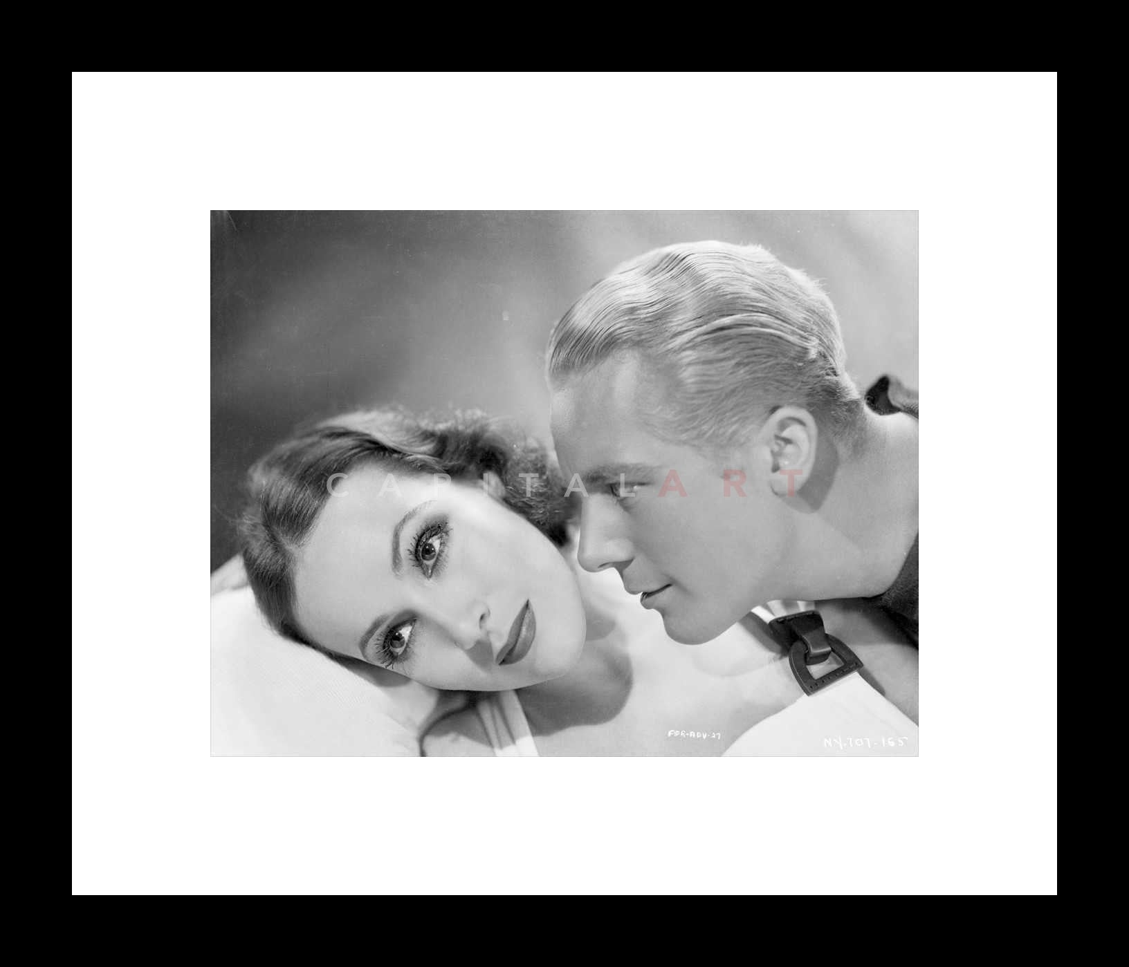 598c1d4a2 Couple posed in a Scene With Roger Bond and Dolores Del Rio From ...