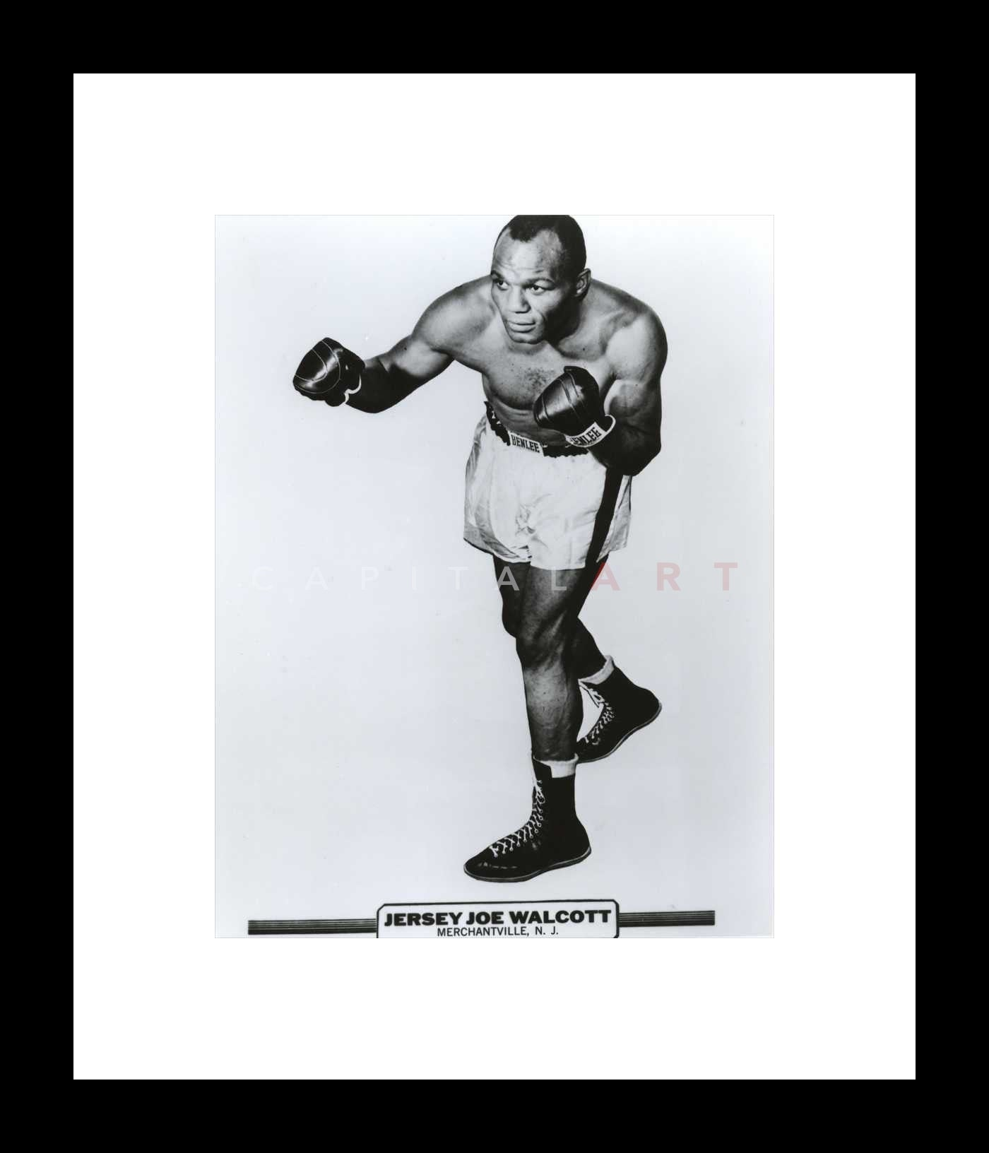Jersey Walcott Boxing Pose in Black Gloves and White Boxer Shorts ...