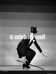 Fred Astaire on Stairs in Black Suit and Tie Premium Art Print