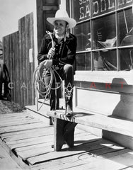Gene Autry Seated on Chair with his Legs Crossed Premium Art Print