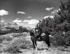 Gene Autry Seated with a Horse Premium Art Print