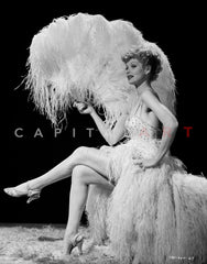 Lucille Ball Dancing in White Long Gown with One Hand Raise Premium Art Print