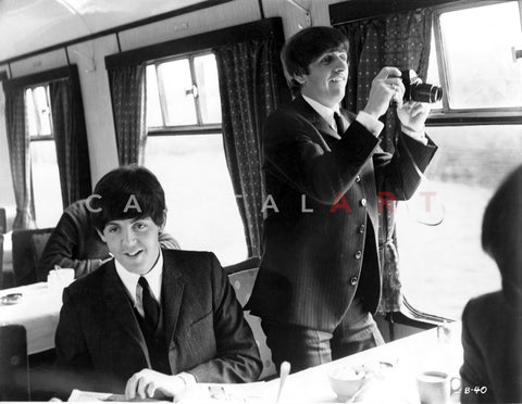 Beatles Paul McCartney Hand on the Table and Ringo Starr standing Holding a Camera Premium Art Print