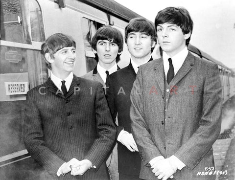 Beatles Group Picture standing Besied a Train in Black and Grey Suit Premium Art Print