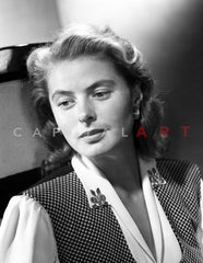 Ingrid Bergman sitting on a Couch in a Long Sleeve Dress with Brooch Premium Art Print