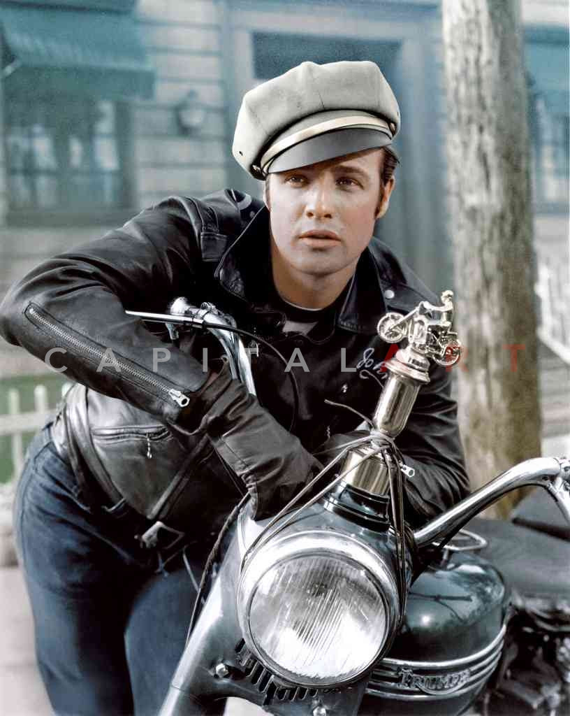 "Marlon Brando propped against his Triumph Engineering Motorcycle in ""The Wild One"""