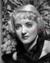 Bette Davis Portrait smiling and Looking Up In Polka Dot Black Dress with Short Curls Premium Art Print