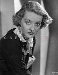 Bette Davis Portrait Looking Serious in Black Suit Dress and Black Gem Necklace with Middle parted Curls Premium Art Print