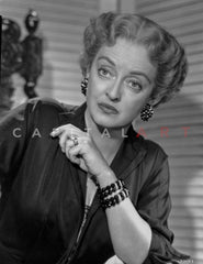 Bette Davis Seated with Arms Cross and Hands Laid on the Lap in Black Sheer Long Sleeve Dress Premium Art Print