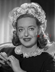 Bette Davis Seated on Chair with Hands Together in Black V-Neck Folded Long Sleeve Dress and Bracelet with Marcel Wave Hair Premium Art Print