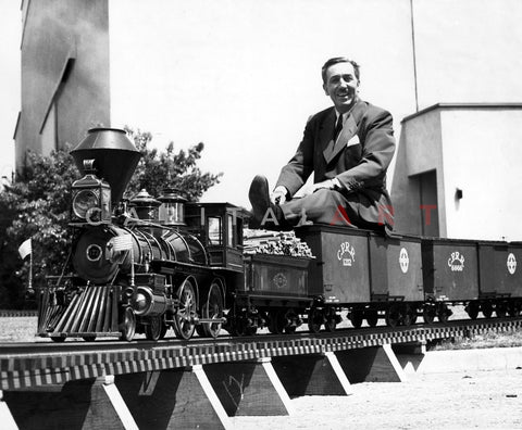 WALT DISNEY Operating his Outdoor TOY TRAIN Railroad, c.1950s
