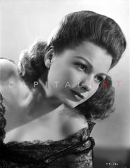Anne Baxter smiling and Leaning Premium Art Print