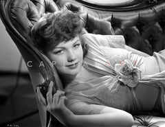 Anne Baxter posed on Floral Dress sitting and smiling Premium Art Print