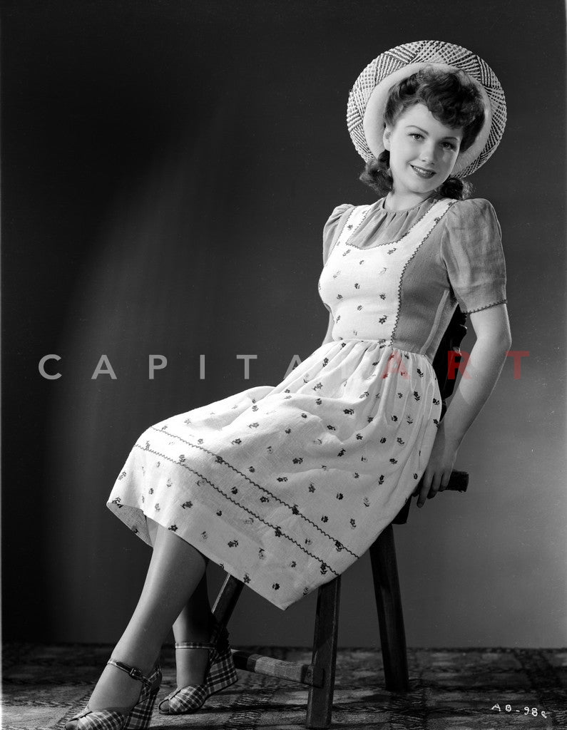 Anne Baxter on Printed Top sitting and smiling Premium Art Print