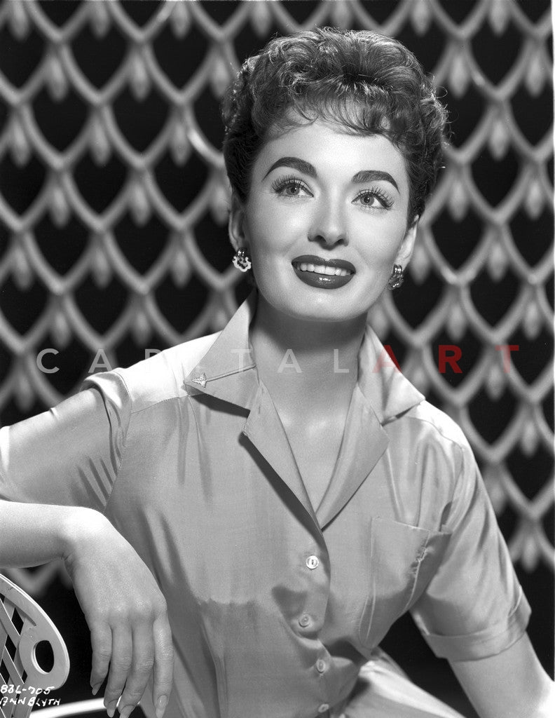 Ann Blyth sitting and smiling wearing a Glossy Blouse Portrait Premium Art Print