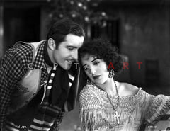 Bebe Daniels Listening to the Man in Polka Dot Sleeve Shirt while Seated in Knitted Dress Premium Art Print